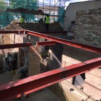 Building up roof structure for a tree storey building on Lewisham High Street10